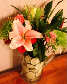 """Sliced lime pitcher """"vase"""" with a spring arrangement from Sweet Hubby."""