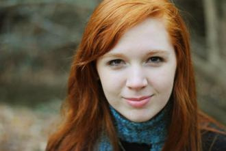 Redheaded girl in a sweater and scarff