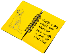 black notebook with dog
